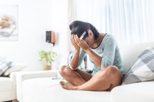 Infertile Woman Finds Out The Positive Result Of Her Pregnancy Test.